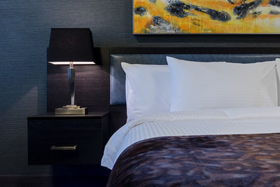 King bed at Applause Hotel by CLIQUE, Calgary Airport