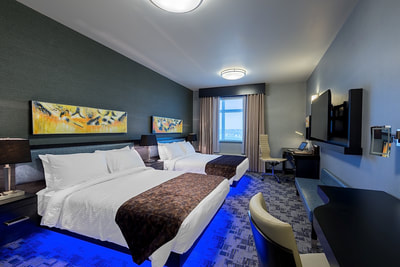 Double bed at Applause Hotel by CLIQUE, Calgary Airport